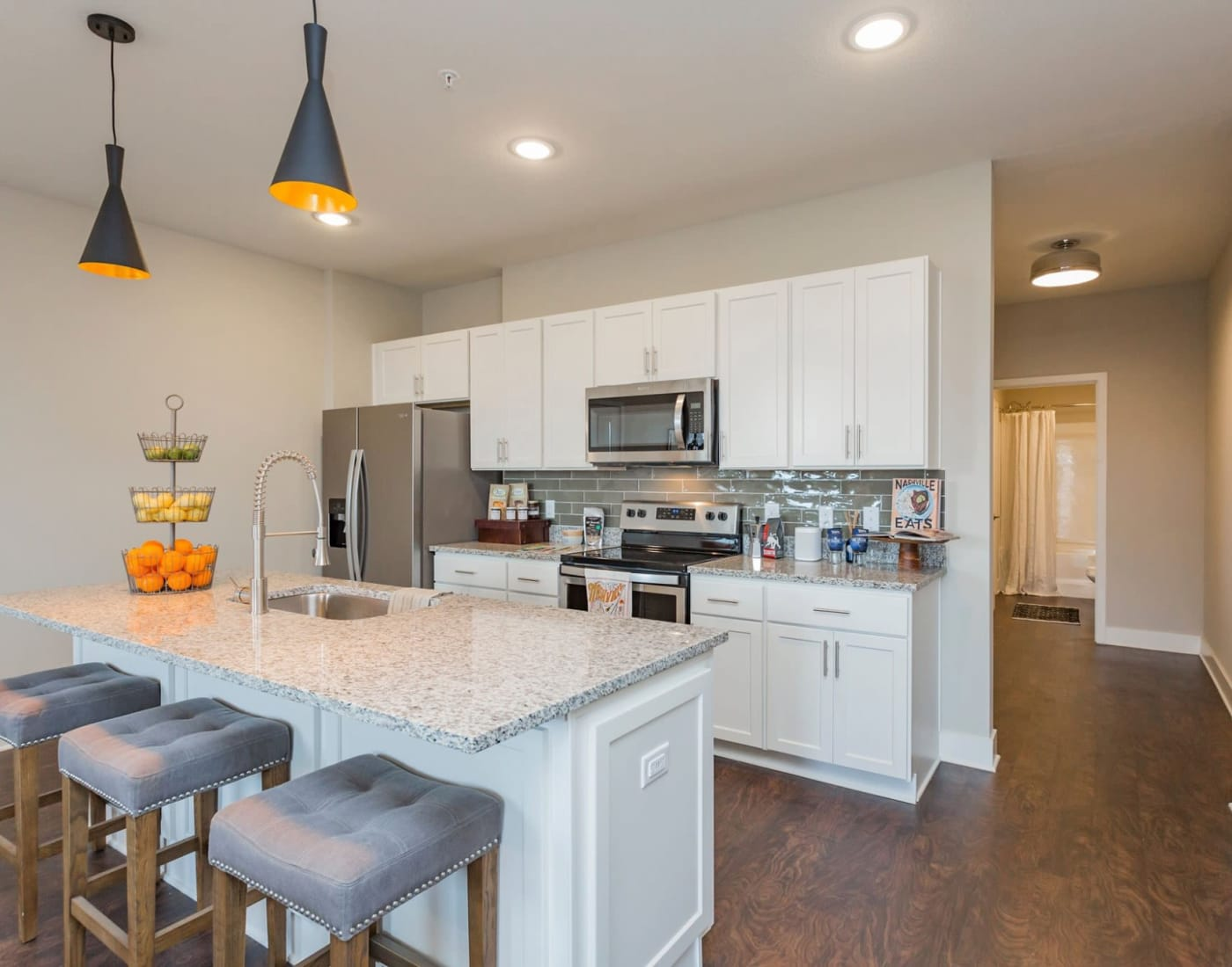 Kitchen with a breakfast bar at Rivertop Apartments in Nashville, Tennessee