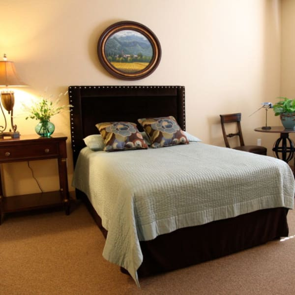 Bedroom in an apartment at Quail Park Memory Care Residences of Visalia in Visalia, California