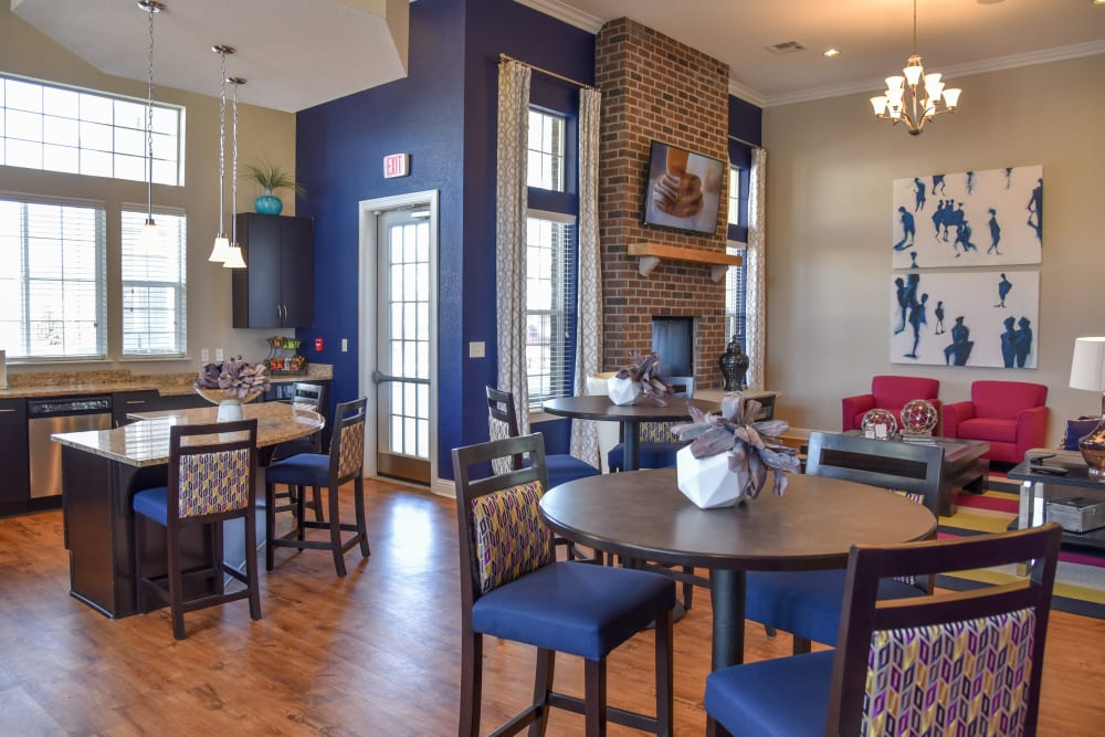 Clubhouse with Pub Chairs and Kitchen Area at Springs at Egan Drive in Savage, MN
