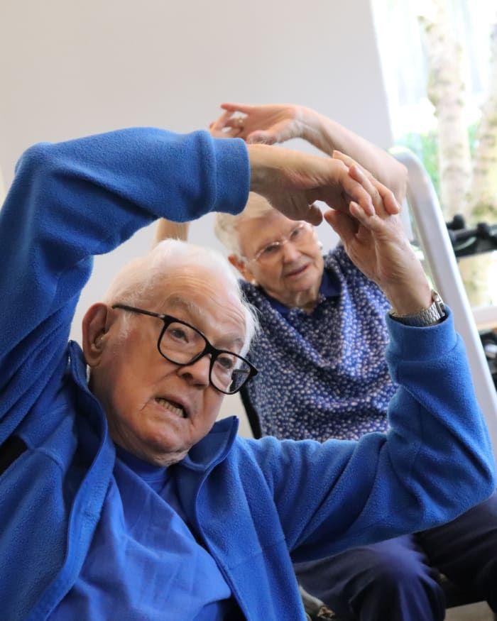 Resident enjoying fitness class at The Springs at Clackamas Woods in Milwaukie, Oregon
