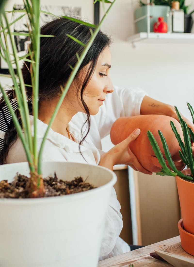 Resident watering her plants at Marquis at Silverton in Cary, North Carolina
