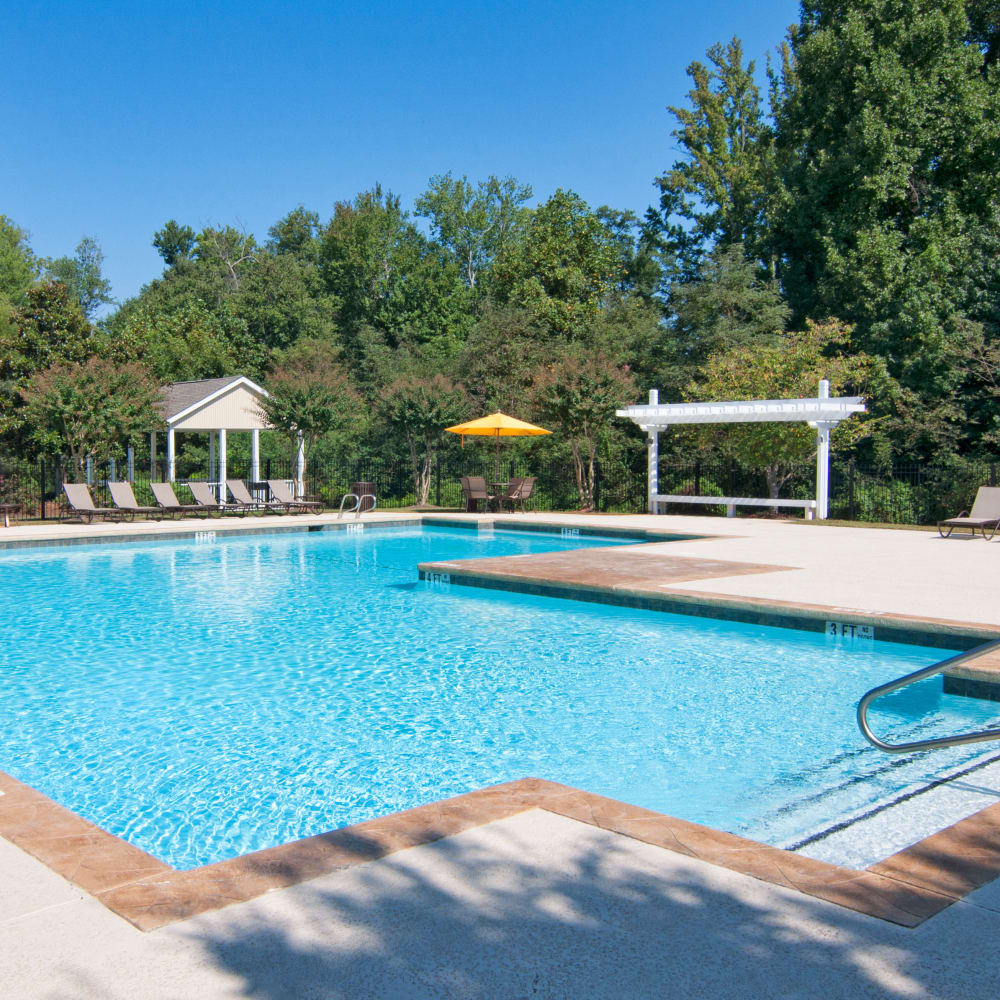 Large resident swimming pool at Amber Chase Apartment Homes in McDonough, Georgia