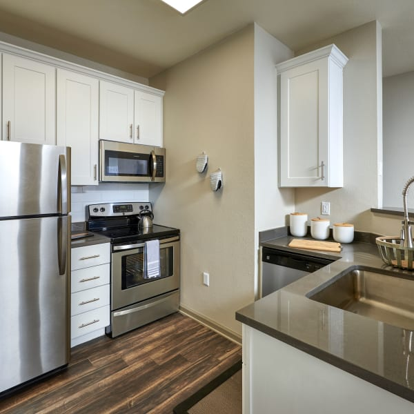 open kitchen view - white model renovation, newly remodeled at Gateway Park Apartments in Denver