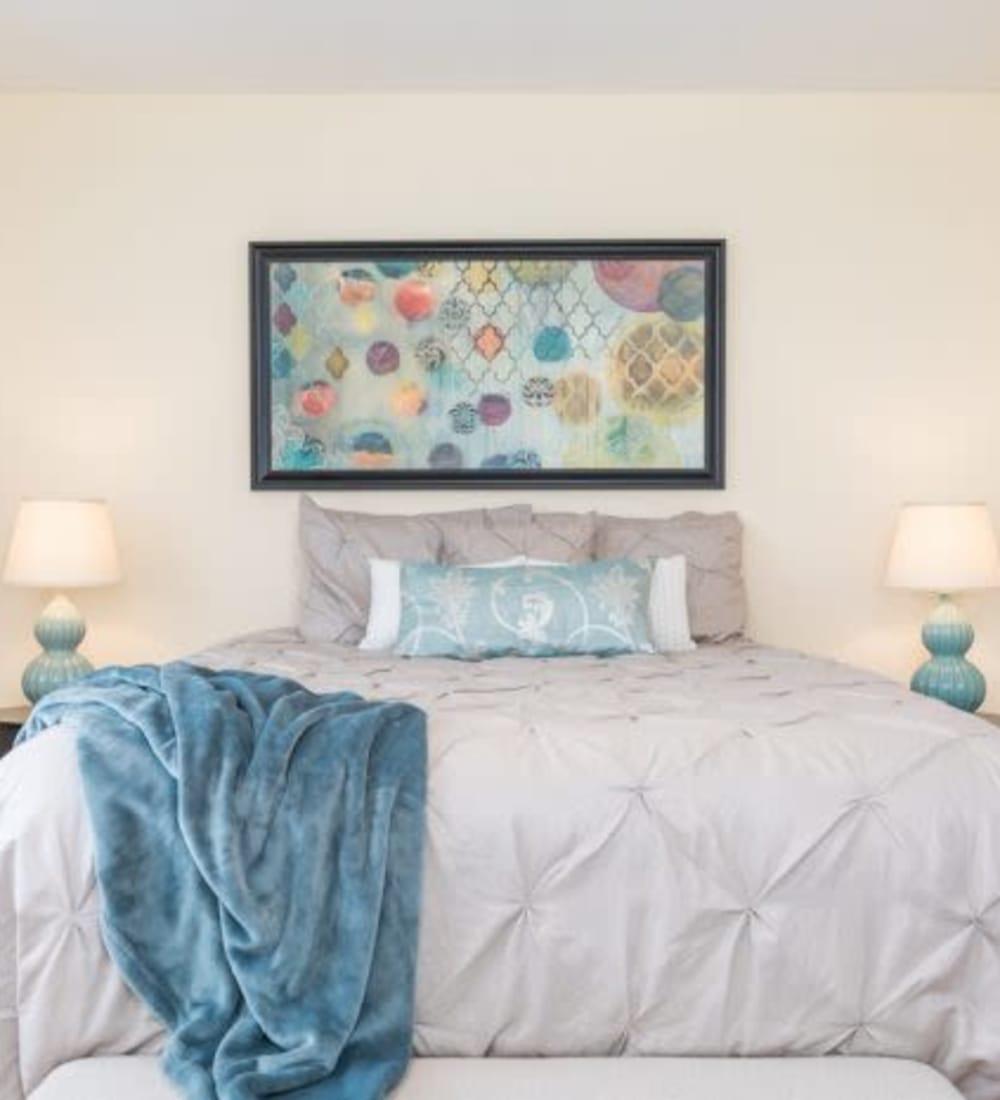 Cozy bedroom at Olde Hampton Village Apartments in Hampton, New Hampshire