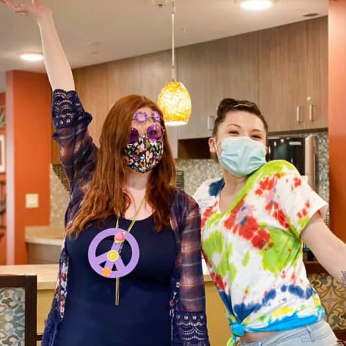 Two masked team members posing for a photo at The Oxford Grand Assisted Living & Memory Care in McKinney, Texas