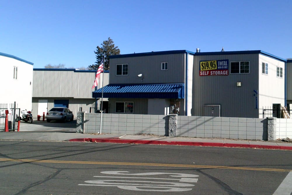 Exterior of A-American Self Storage in Reno, Nevada with gated entry