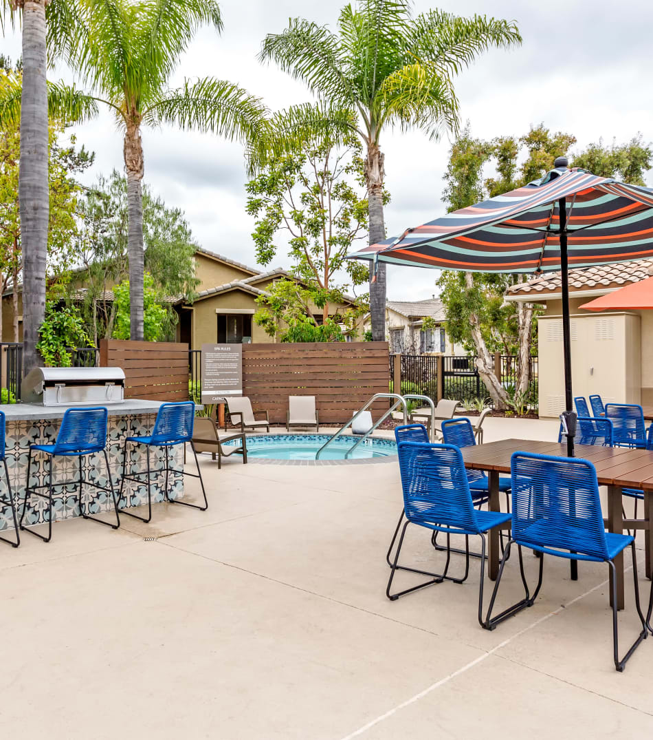 Barbecue area with gas grills near the swimming pool at Sofi Westview in San Diego, California