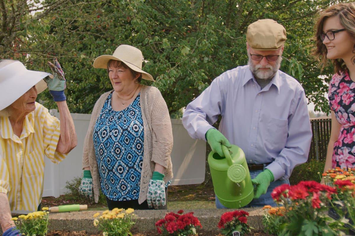 Residents gardening together at Farmington Square Salem in Salem, Oregon