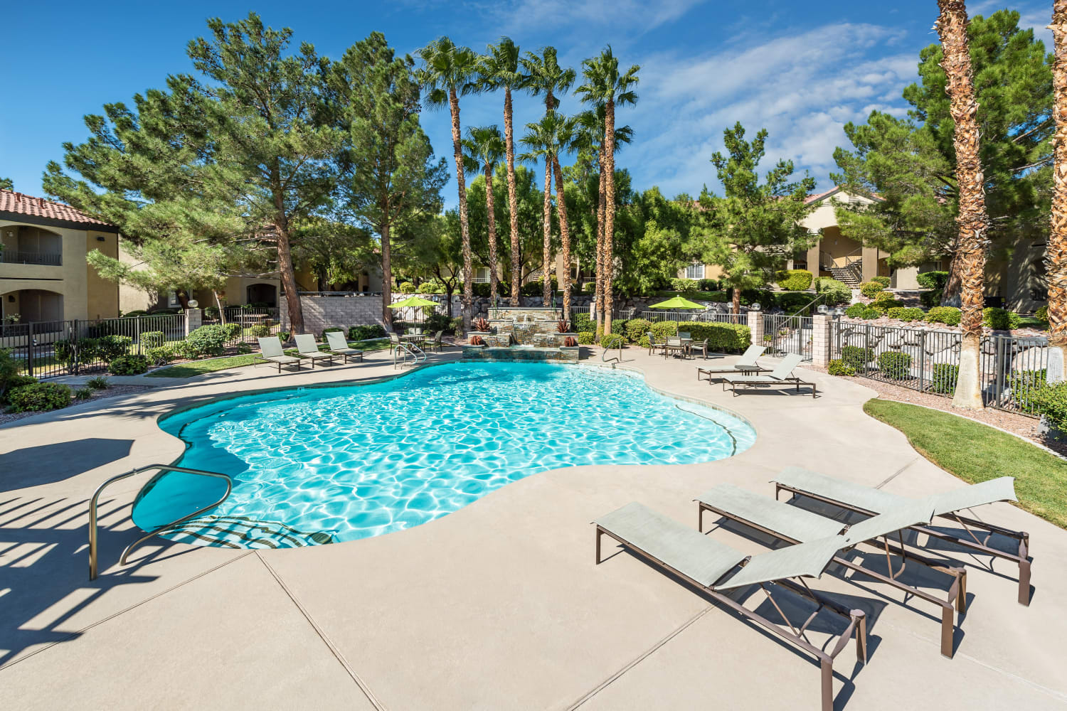Enjoy warm sunshine and a sparkling swimming pool at Rancho Destino Apartments in Las Vegas, Nevada