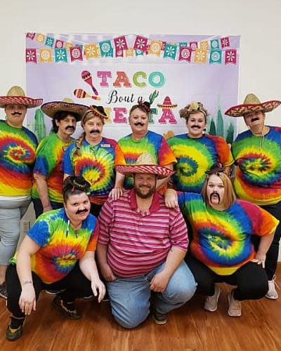 Staff members dressed up for fiesta night at Garden Place Waterloo in Waterloo, Illinois.