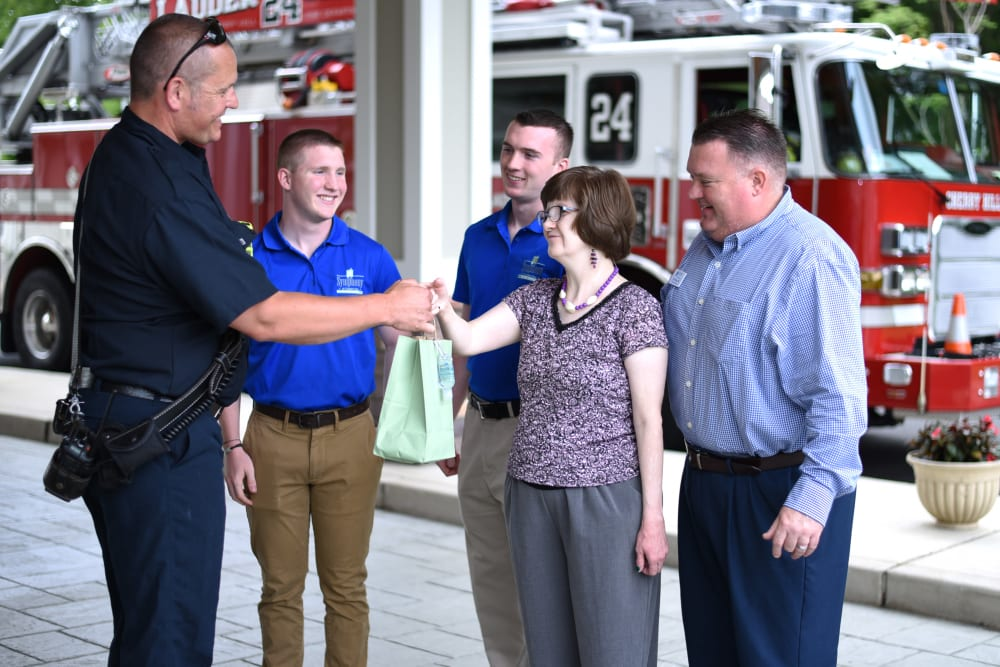 Community executive director shaking hands with firefighter