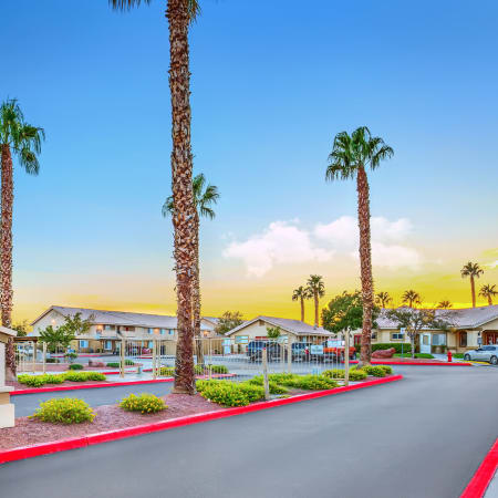 Driveway entrance to leasing office at sunset of Portola Del Sol in Las Vegas
