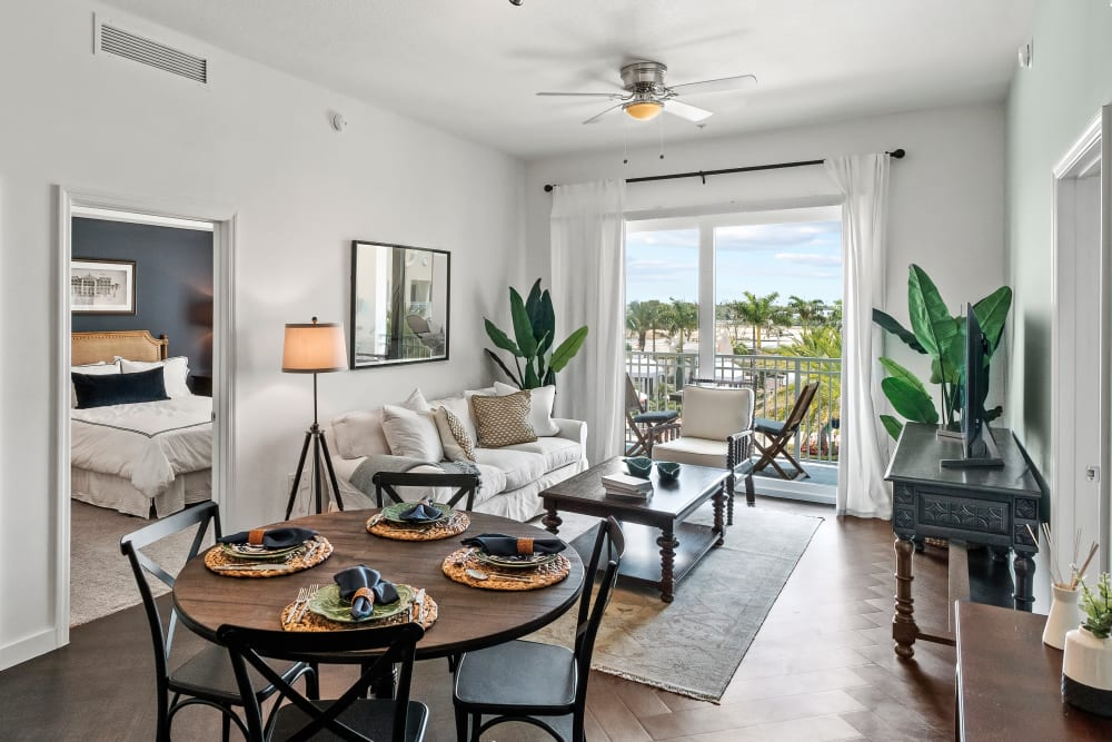 Living and dining area in a model apartment home at Town Lantana in Lantana, Florida