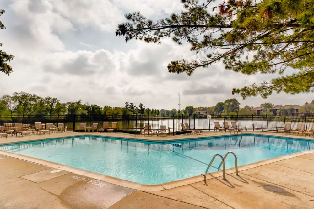 Swimming pool with a large sundeck at Lakeside Apartments in Wheaton, Illinois
