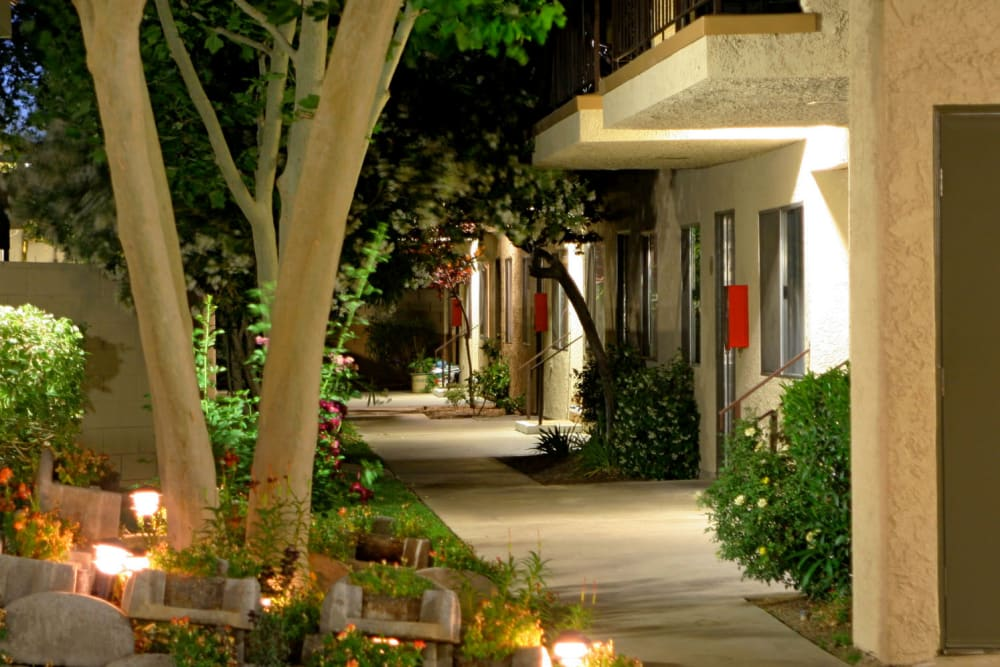 Evening lights illuminating flowers outside resident apartments at Parkwood in Lancaster, California