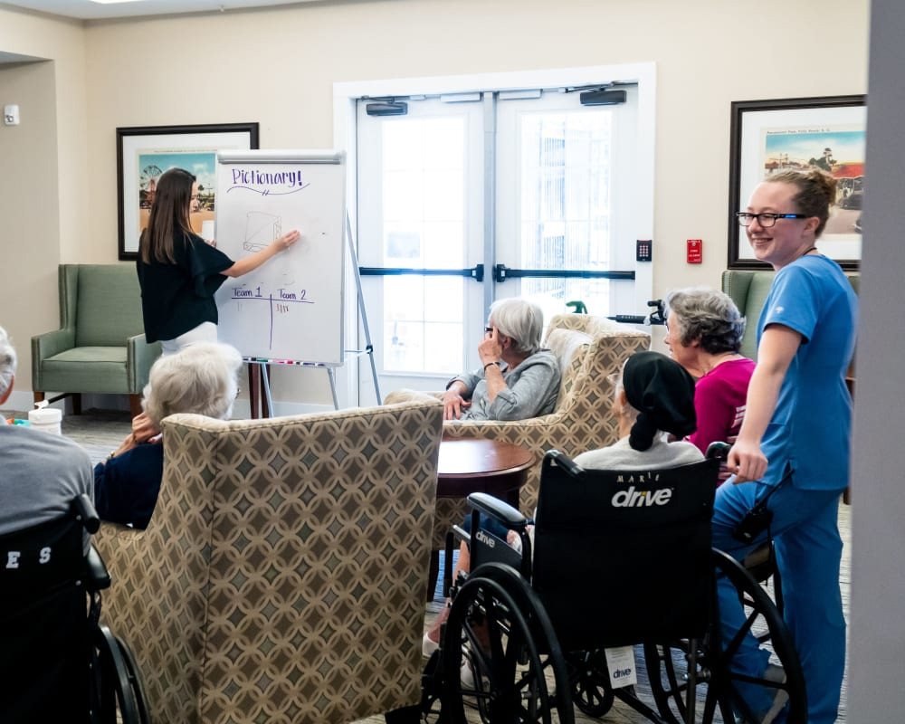 Memory care residents enjoy a game of Pictionary at Harmony at West Ashley in Charleston, South Carolina