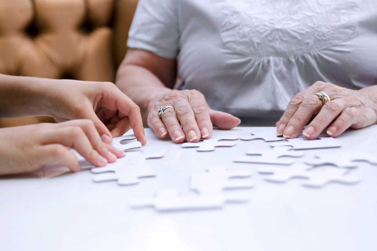 Residents solving a puzzle at Glen Carr House Memory Care in Derby, Kansas
