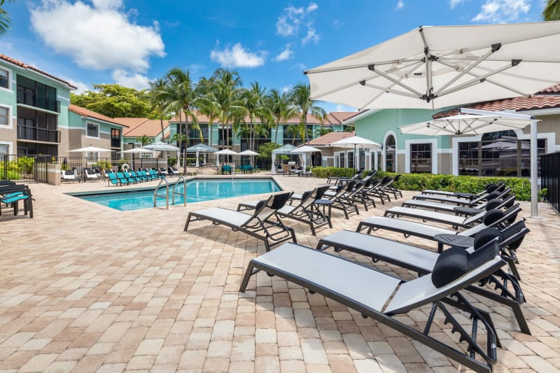 Lounge chairs by the outdoor pool at The EnV in Hollywood, Florida