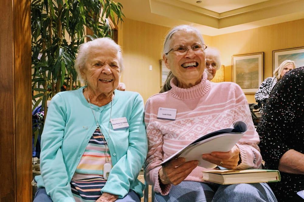 Two resident friends laughing at Merrill Gardens at Oceanside in Oceanside, California.