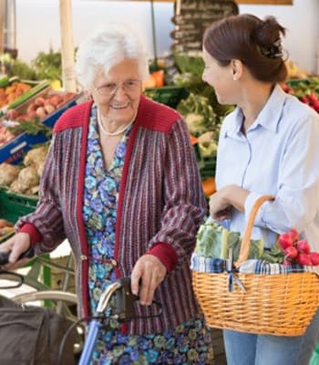 Resident and caretaker shopping at the grocery store near The Retreat at Lady's Island in Beaufort, SC