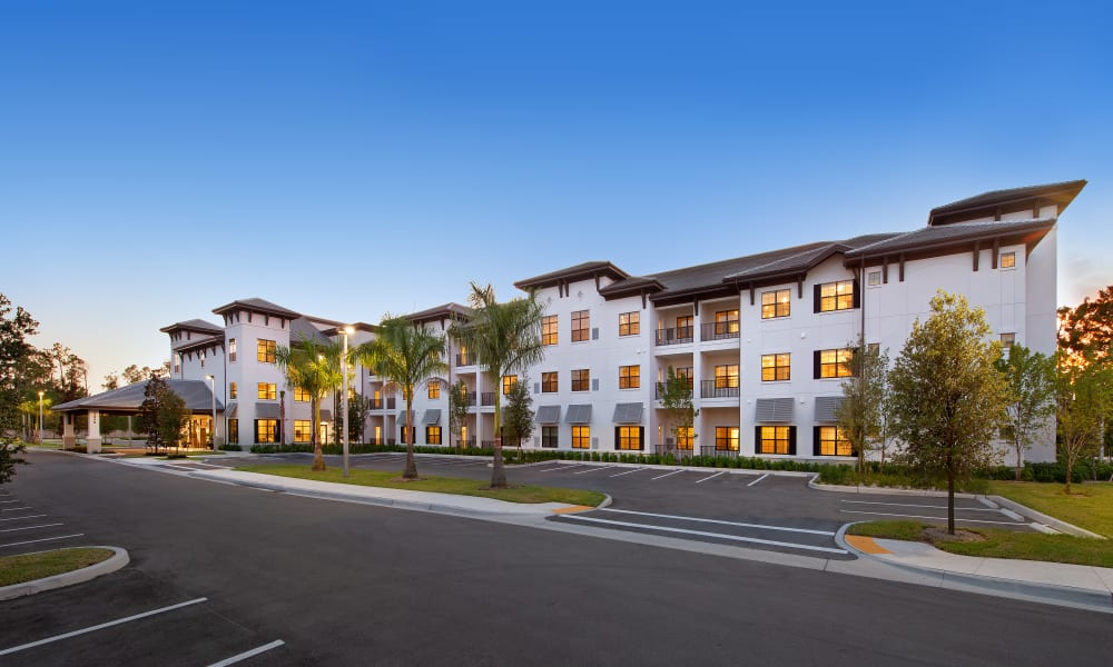 View of Keystone Place at Naples Preserve's gorgeous front facade in Naples, Florida