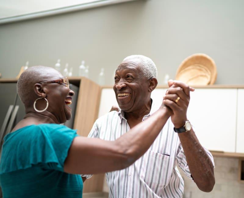 Resident couple dancing together at Arbor Glen Senior Living in Lake Elmo, Minnesota