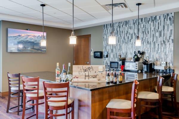 Island seating bar and lounge at Arbor Glen Senior Living in Lake Elmo, Minnesota