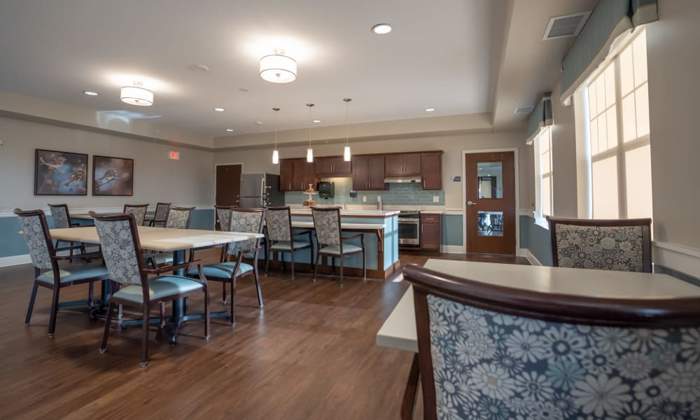 Resident community space with kitchen and tables at The Sanctuary at St. Cloud in St. Cloud, Minnesota
