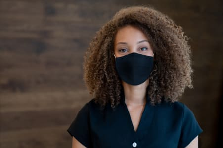 Young woman wearing a mask in response to COVID-19