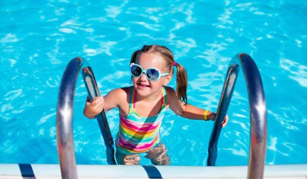 A child in the pool at Cleveland, Tennessee near Parktowne Apartments
