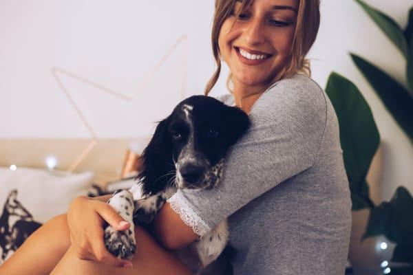 Resident hugging her dog at San Artes in Scottsdale, Arizona