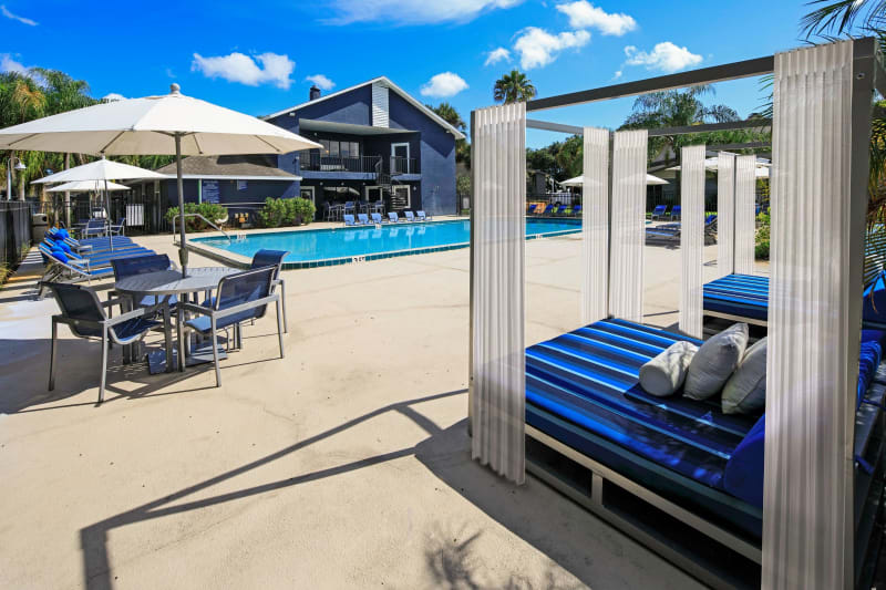 Shaded seating and cabanas near the swimming pool at WestEnd At 76Ten in Tampa, Florida