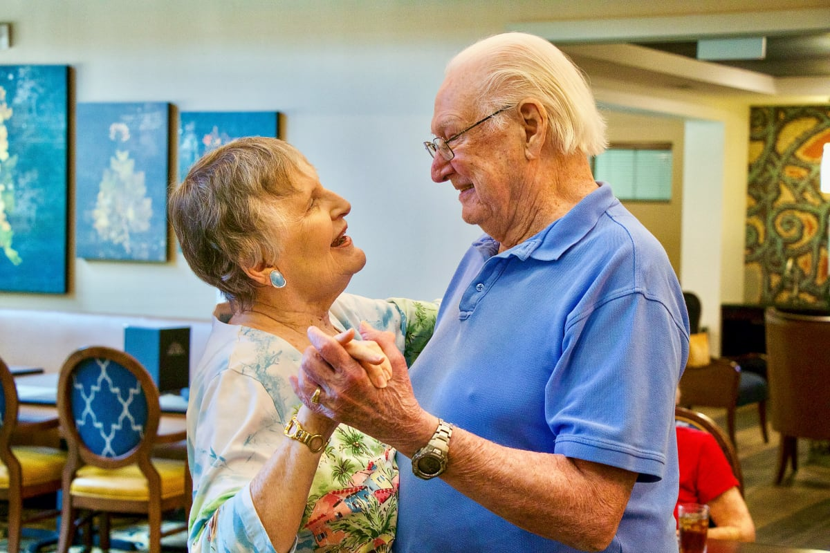Couple dancing together at Isle at Cedar Ridge in Cedar Park, Texas