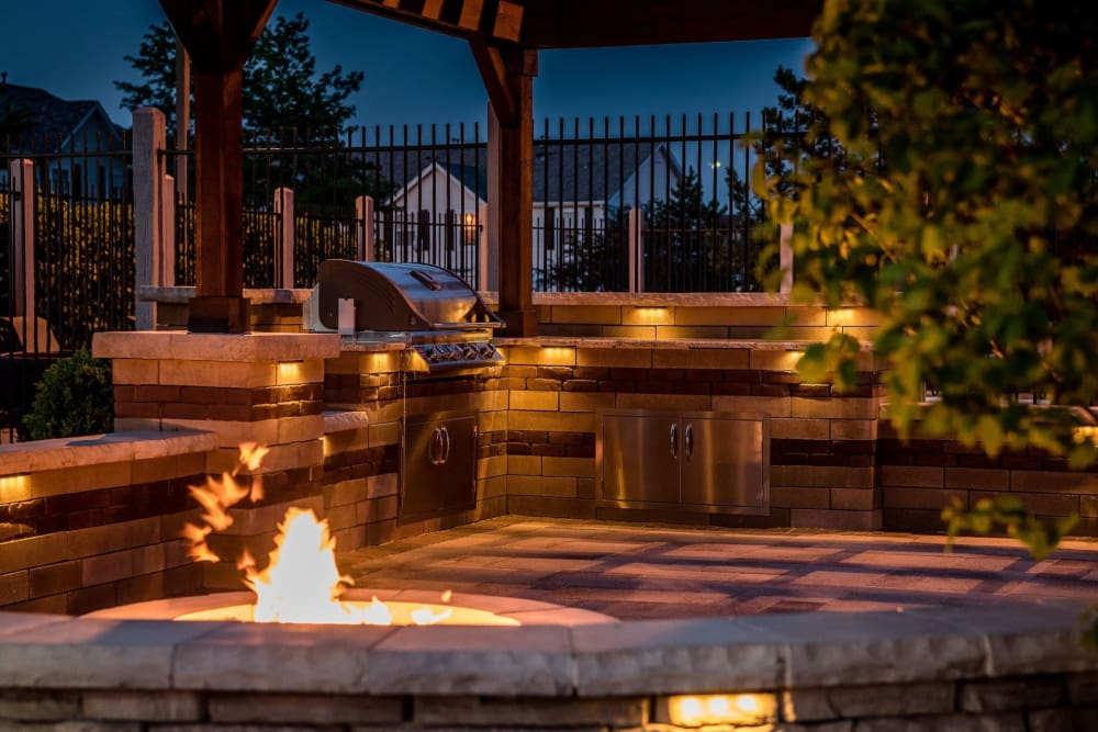 Outdoor Fire Pit and Grill space at Lakeview Townhomes at Fox Valley