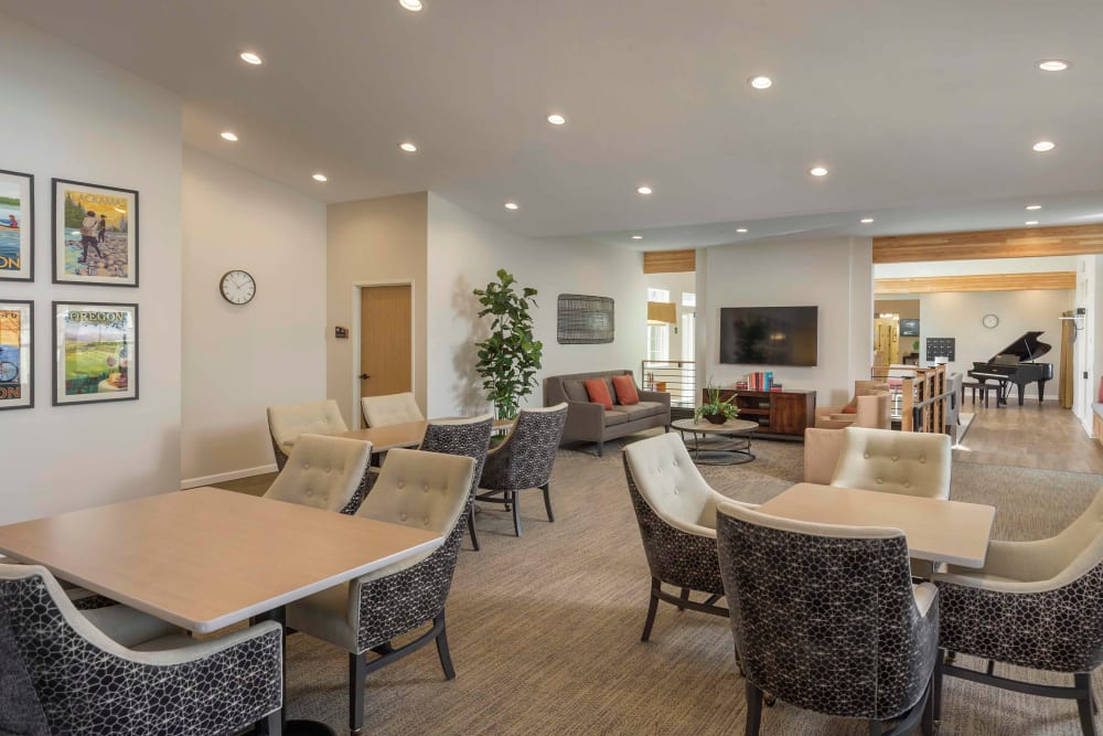 Spacious lounge area with piano in The Springs at Clackamas Woods at Milwaukie, Oregon