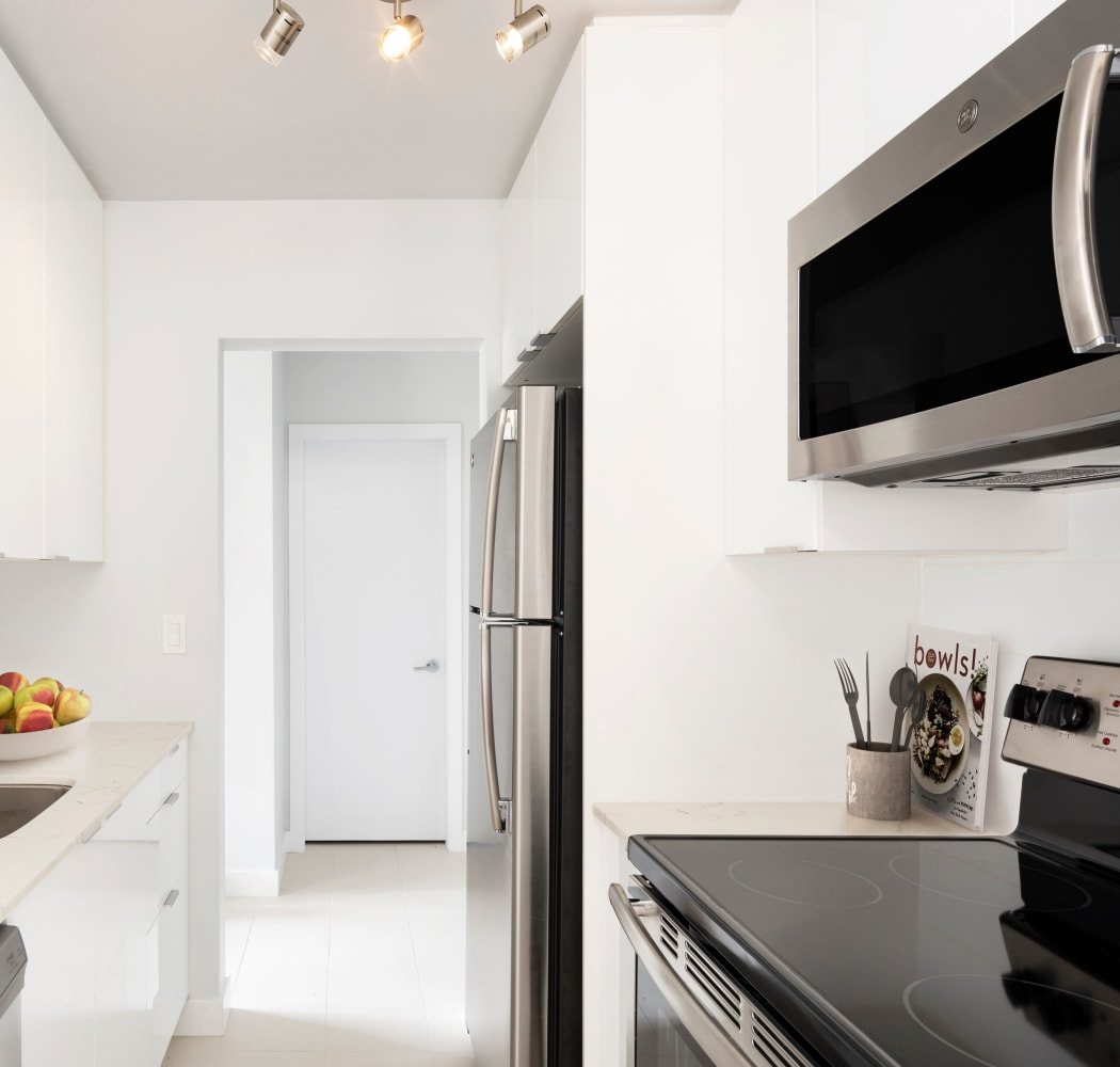 Magnificent kitchen with stainless-steel microwave at Fraser Tolmie Apartments in Victoria, British Columbia