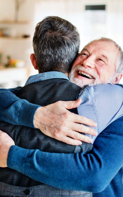 Two residents hugging at Jaybird Senior Living