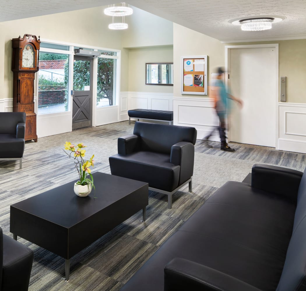 Community lounge near elevator at Fraser Tolmie Apartments in Victoria, British Columbia