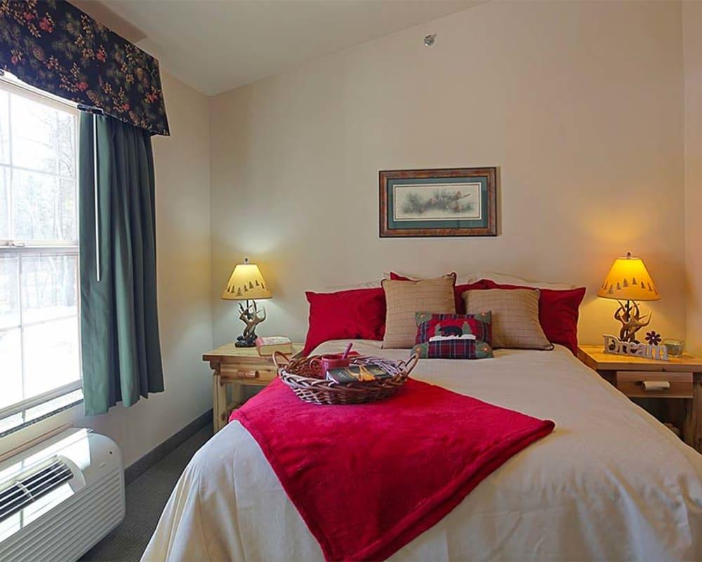 Cozy resident bedroom at Milestone Senior Living Eagle River in Eagle River, Wisconsin.