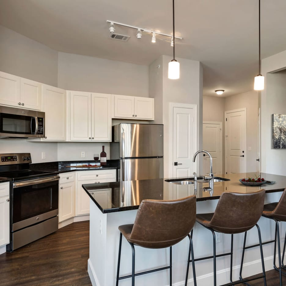 An apartment kitchen at Boulders at Overland Park Apartments in Overland Park, Kansas