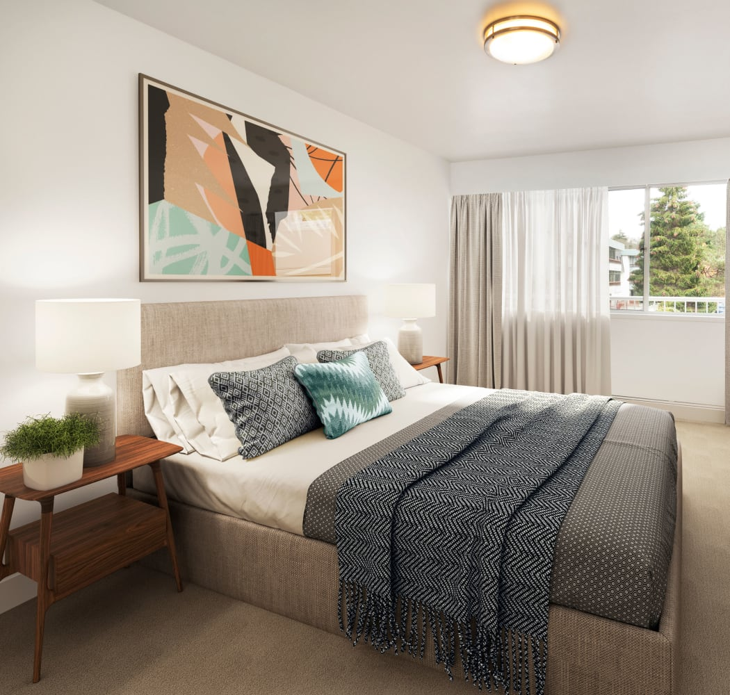 Beautiful model bedroom with unique art decor at Fraser Tolmie Apartments in Victoria, British Columbia