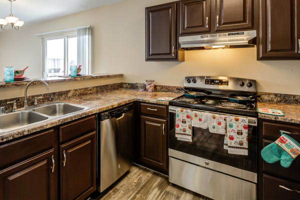 A view of the kitchen at Belle Creek Apartments in Henderson, CO