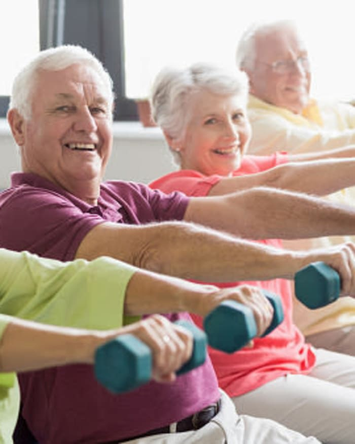 Residents working out at fitness center at The Springs at Anna Maria in Medford, Oregon