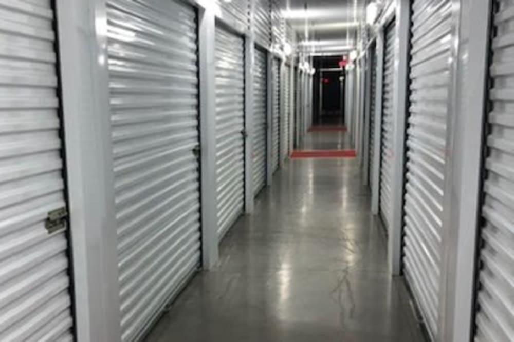 Long hallway of interior storage units at Storage Star Quail Creek in Laredo, Texas