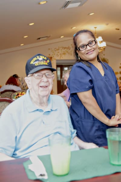A resident poses for a picture with a staff member at Providence Assisted Living in Springdale, Arkansas.