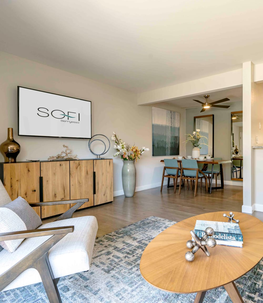 Well-decorated open-concept living space next to the dining area in a model home at Sofi Berryessa in San Jose, California