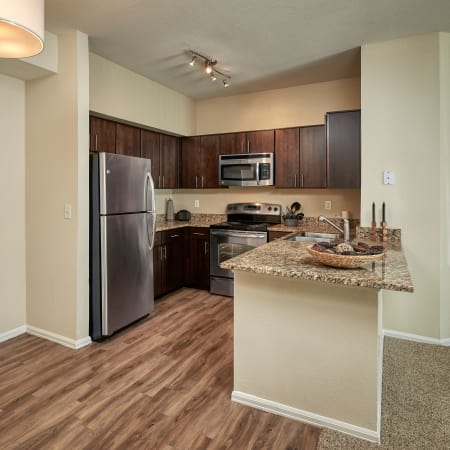 brown renovated kitchen at The Crossings at Bear Creek Apartments in Lakewood