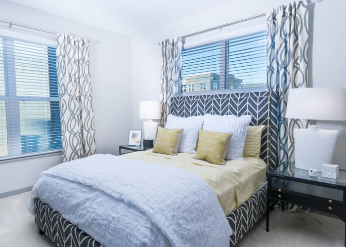 Beautiful bedroom with plenty of natural lighting at Palmer House Apartment Homes in New Albany, Ohio