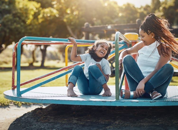 A women and her daughter enjoying the local playground near Southtown Apartments in Monmouth, Oregon