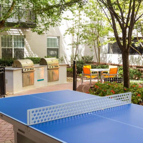 Outdoor ping pong table overlooking BBQ and dining area at Marq on Ponce in Atlanta, Georgia